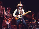 Rolling Thunder Revue (2019) Genre: DocumentaryDirector: Martin ScorseseCast: Bob Dylan, Allen Ginsberg, Joan BaezScorsese's playful Netflix concert-docufilm brings 2019's bells and whistles to Bob Dylan's unique 1975 Rolling Thunder Revue tour. The film is full of stolen moments – Dylan and Allen Ginsberg visiting Jack Kerouac's grave, impromptu jams at house parties, a young Sharon Stone in thrall of Dylan. It rarely strays from the man himself, but if you're here for him, it's more than enough. His retrospective musings are lyrical treasures.